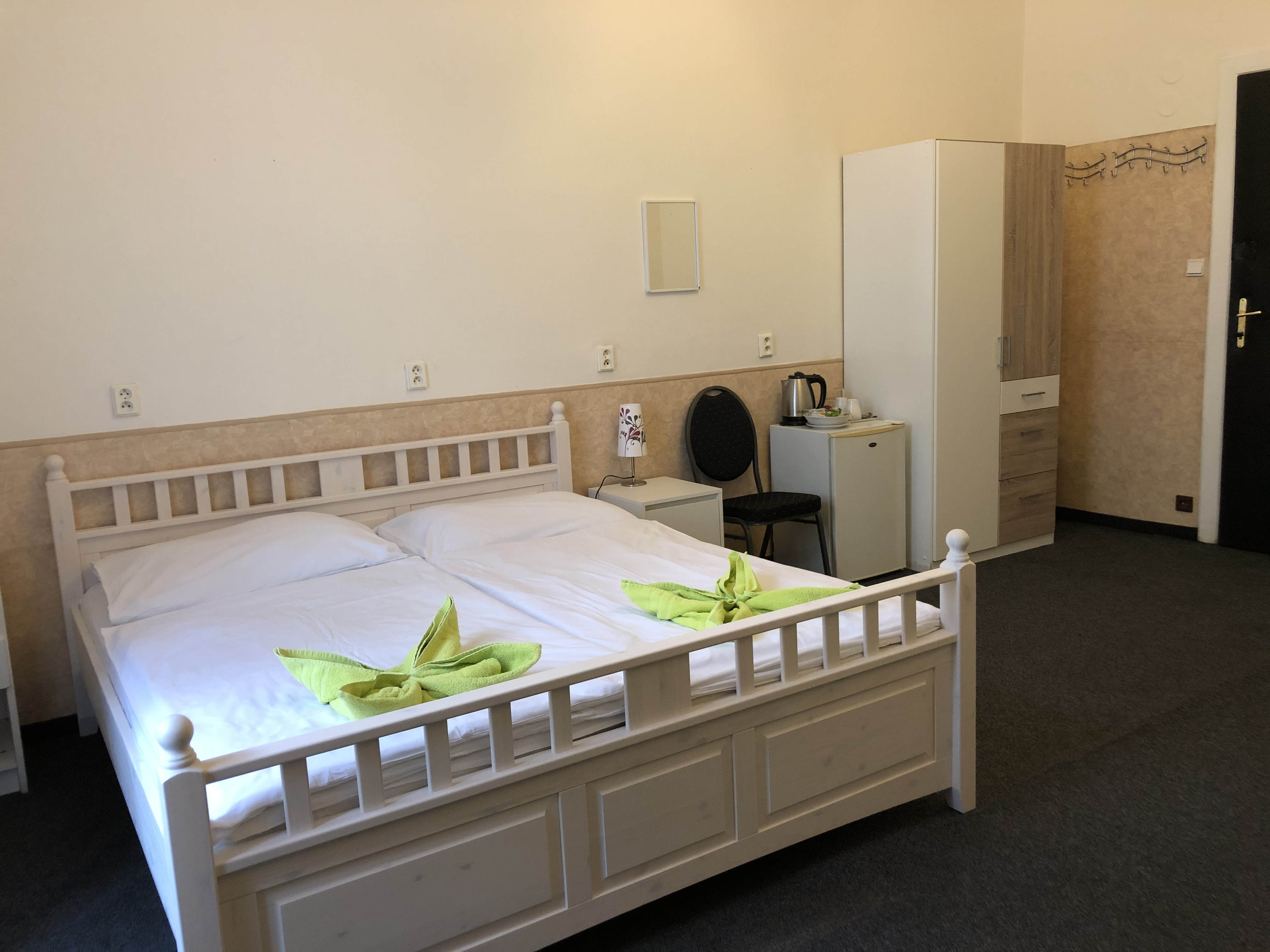 A double-bed room with shared bathroom